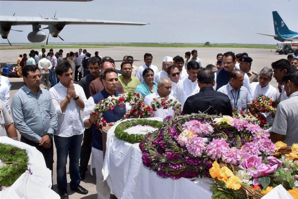 Gujarat chief minister Vijay Rupani and his deputy Nitin Patel pay tributes to Amatnath pilgrims whose bodies were brought in an IAF plane at the airport in Surat on Tuesday.