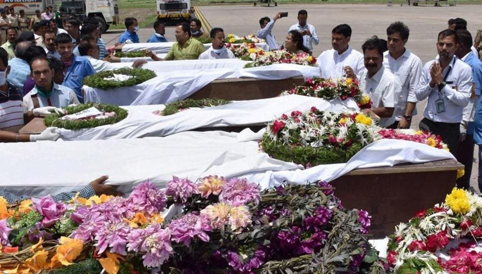People pay tributes to the Amarnath pilgrims who were killed in Monday's terrorist attack at Anantnag in Jammu and Kashmir after their bodies were brought in an IAF plane to the airport in Surat on Tuesday.