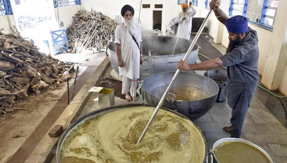 Preparations of community langar by the SGPC workers at Golden Temple  in Amritsar on Friday.