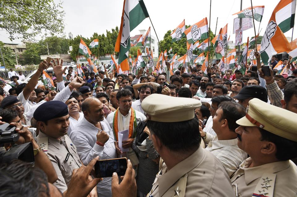 Congress supporters protested outside the police commissioner's office in Gurgaon.