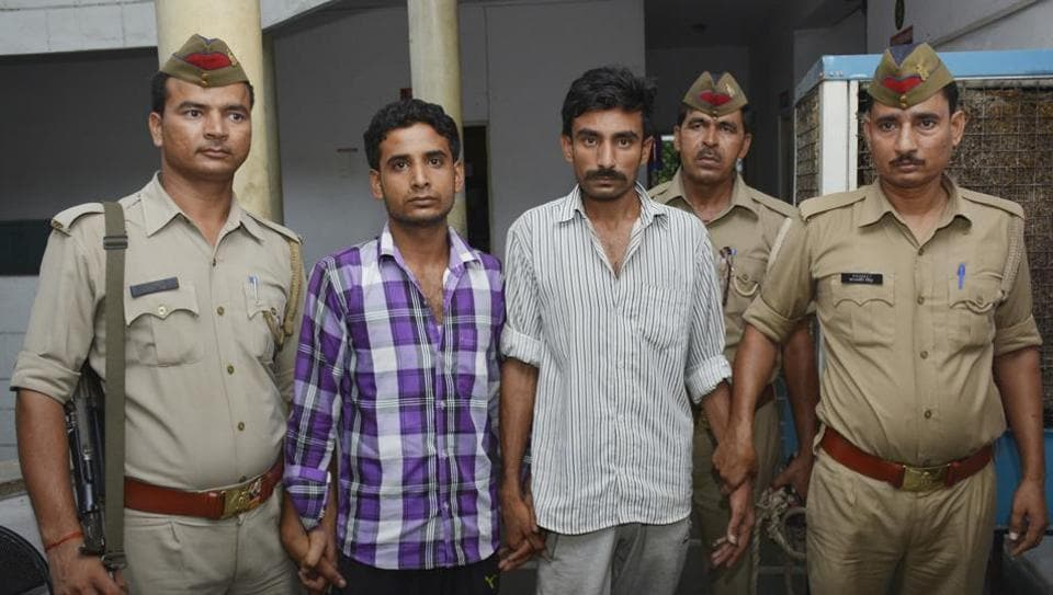 Prime accused Sandeep Jatav (right) and his accomplice Shobhit in police custody on Tuesday.