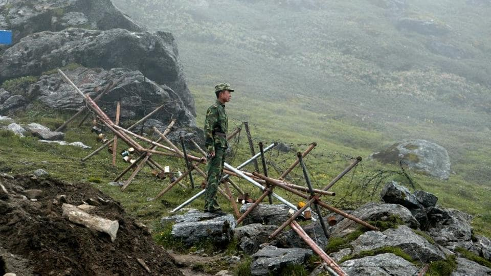 In this photograph taken on July 10, 2008, a Chinese soldier stands guard on the Chinese side of the ancient Nathu La border crossing between India and China.