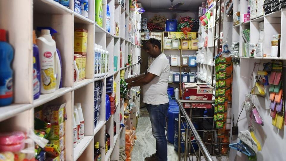 An Indian shopkeeper arranges goods on a shelf inside his shop in New Delhi on August 3, 2016. Finance Minister Arun Jaitley said India was on the cusp of its biggest tax reform since independence ahead of a vote in parliament later August 3 on a new national sales tax. The Goods and Services Tax (GST) will replace a patchwork of central and state levies on goods and services and is one of Prime Minister Narendra Modi's biggest reforms since taking power in May 2014. / AFP PHOTO / SAJJAD HUSSAIN