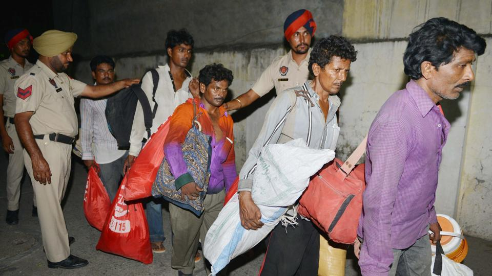 Indian fishermen arrive at a Red Cross House after being released by Pakistani authorities, in Amritsar on July 10.
