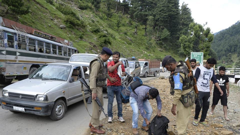 Indian paramilitary troopers search bags of Hindu pilgrims at Pahalgam in Anantnag district, southeast of Srinagar, during the annual Hindu pilgrimage to the Amarnath shrine cave on July 11, 2017
