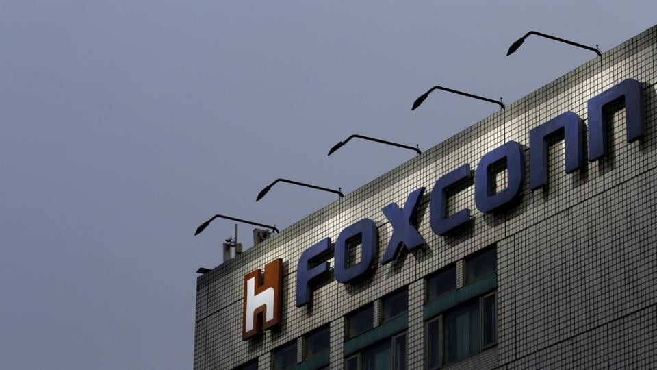 The logo of Foxconn, the trading name of Hon Hai Precision Industry, is seen on top of the company's headquarters in New Taipei City, Taiwan. Referring to the commitment by Foxconn and Midea to invest in India, the Global Times article said these investments are coming close on the heels of India's decision to implement the Goods and Services Tax (GST).