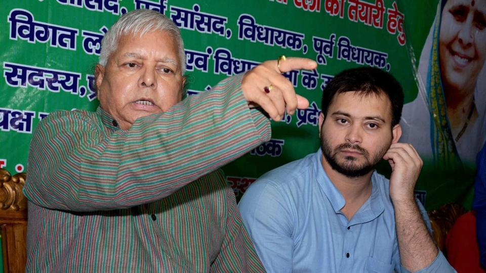 RJD chief Lalu Prasad addresses a press conference with his son and Bihar deputy chief minister Tejashwi Yadav at his residence in Patna on Friday after CBI raids at his premises.