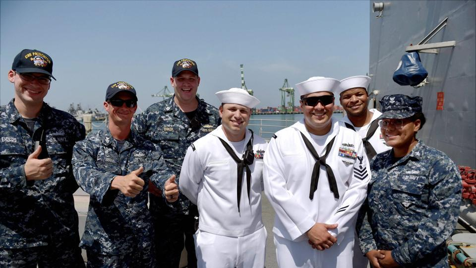 US sailors pose for the media on-board USS Princeton which arrived at the Chennai Port Trust to take part in the India, Japan and United States joint Malabar Naval Exercise that began in Chennai on Monday.)
