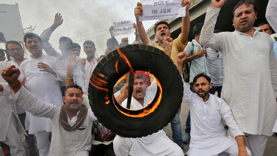 People shout slogans during a protest organised by Jammu & Kashmir National Panthers Party in Jammu on Tuesday.