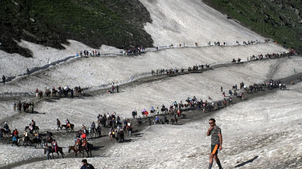 Pilgrims cross mountain trails during their religious journey to the Amarnath cave on the Baltal route, some 125 kms away from Srinagar. (PTI)