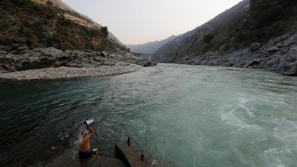 A devotee bathes at the confluence of the Alaknanda and Bhagirathi rivers which form the Ganga in Devprayag, Uttarakhand. The waters here are starkly clear in comparison to further downstream. (Danish Siddiqui / Reuters)