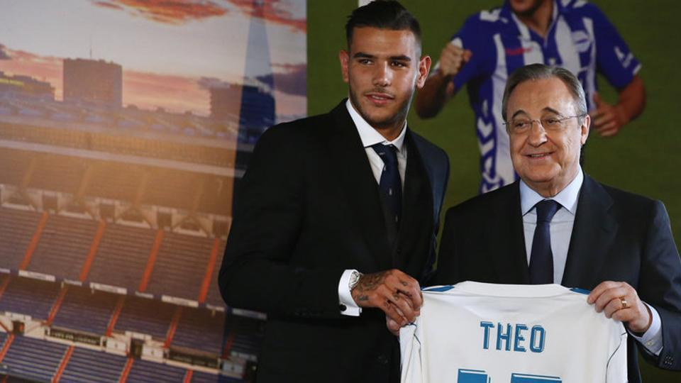 Real Madrid's president Florentino Perez poses with their new signing Theo Hernandez during his presentation at the Santiago Bernabeu in Madrid.