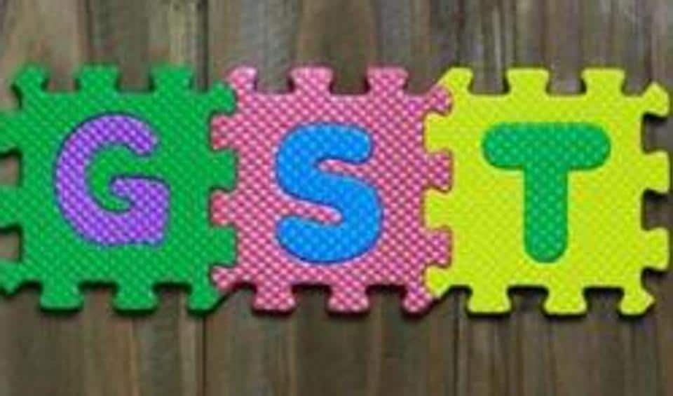 Colourful puzzle block letter with word GST.
