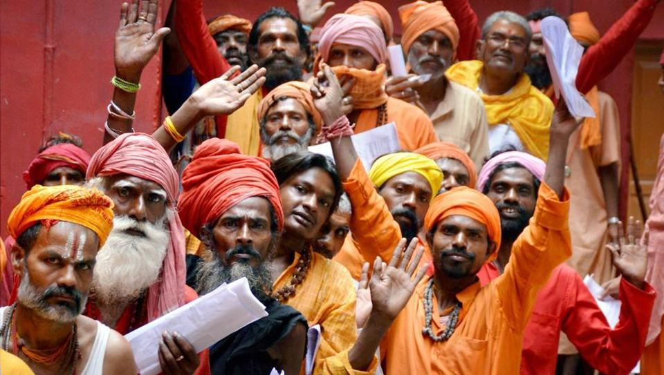 Sadhus wait to register themselves for the Amarnath pilgrimage at a base camp in Jammu on Friday.