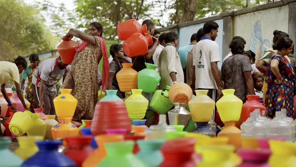 Due to irregular  water supply in the city people have to stand in long queues at  Metro water filling station as the four main reservoirs -- Poondi, Red Hills, Cholavaram and Chembarambakkam  have majorly dried up. (R Senthil Kumar / PTI)