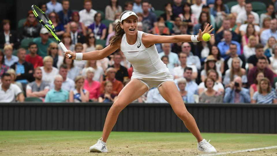 Johanna Konta put in a spirited performance to beat Simona Halep 6-7(2), 7-6(5), 6-4.  (AFP)
