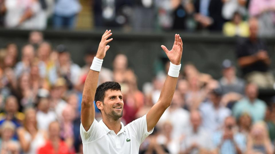 Novak Djokovic gestures to the crowd after beating  Adrian Mannarino during their men's singles fourth round match of the 2017 Wimbledon Championship.
