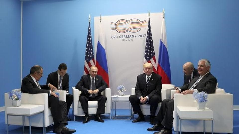 US President Donald Trump and Russian President Vladimir Putin attend a meeting on the sidelines of the G20 summit in Hamburg, Germany, on July 7, 2017.