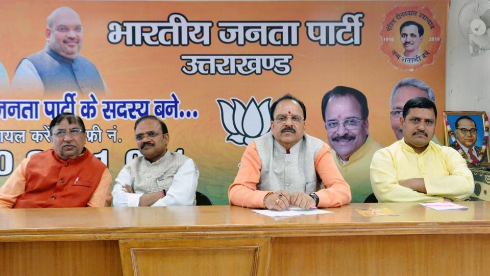 BJP leaders at the meeting with party workers in Dehradun on Tuesday.