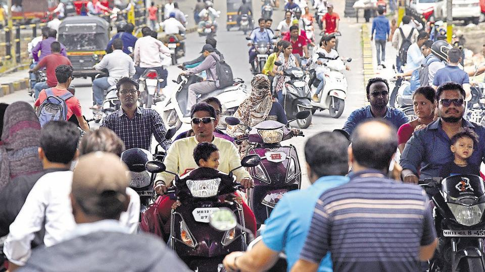 Two wheeler riders not wearing helmets and blatantly ignoring traffic rules is a common sight in Pune.