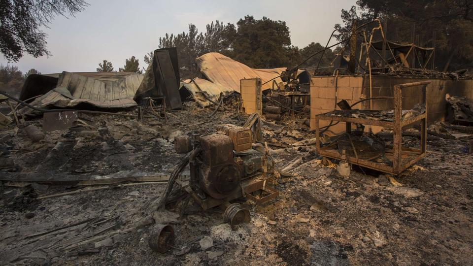 Structures at Rancho Alegre Boy Scouts of America outdoor school are left in ruins after the Whittier Fire swept through Santa Barbara, California. The Whittier Fire and the Alamo Fire together have blackened more than 30,000 acres of chaparral-covered hills in Ventura County.  (AFP)