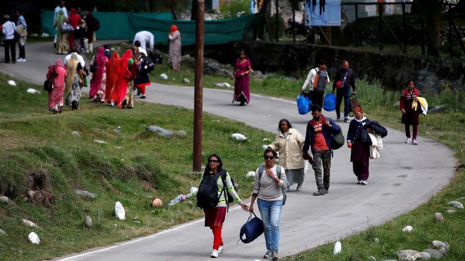Hindu pilgrims arrive after visiting the Amarnath cave shrine in Pahalgam town of south Kashmir's Anantnag district.