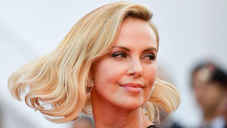 Charlize Theron poses as she arrives on May 23, 2017 for the '70th Anniversary' ceremony of the Cannes Film Festival in Cannes.