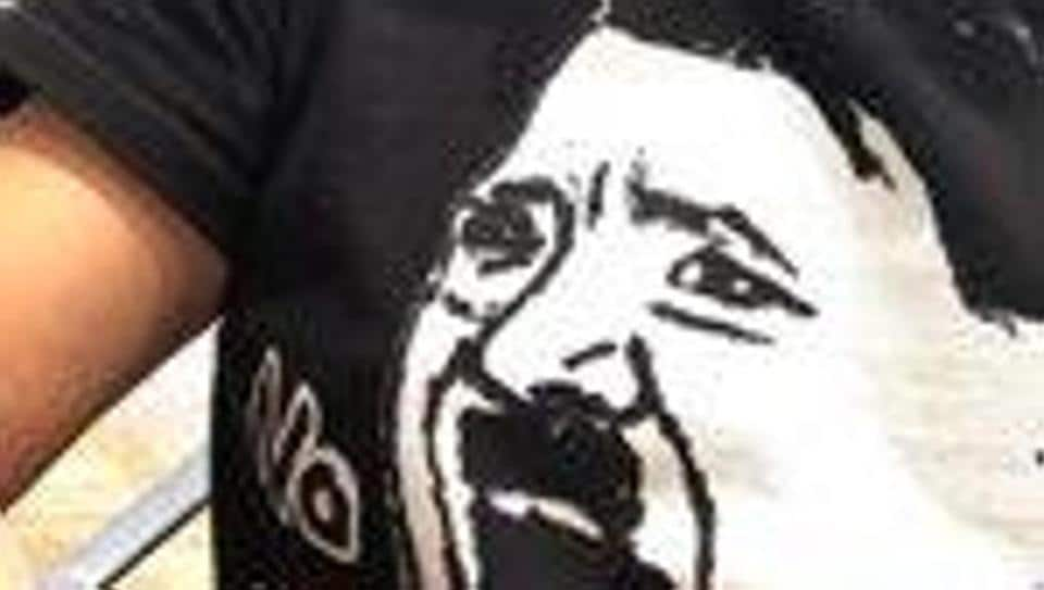 A black T-shirt with a cartoon of Adolf Hitler was worn by Japanese entrepreneur Takafumi Horie.