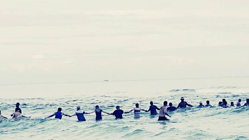 human chain,florida beach,drowning