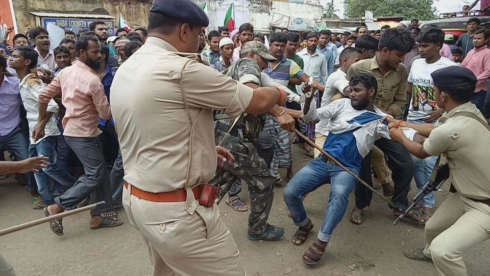 PFI supporters clashing with police in Pakur during their protest march on July 5.