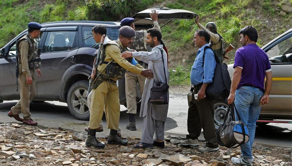 Nuwan Base Camp: Security personnel frisking the yatris and the locals before they head towards the holy cave shrine following the militant attack on a bus in which seven pilgrims were killed and 19 others injured.