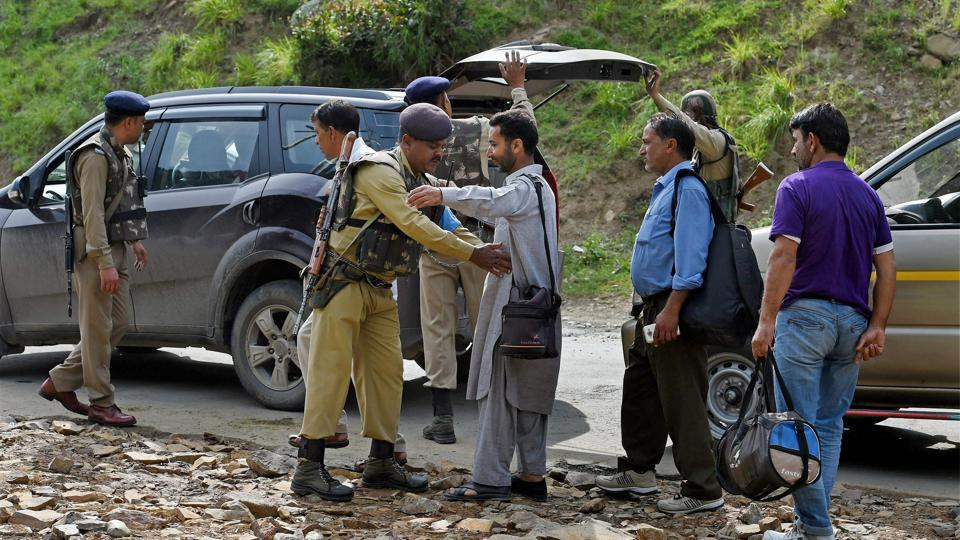 Security personnel frisk pilgrims and locals on their way to the Amarnath shrine after terrorists attacked a bus, killing seven people, at Nuwun base Camp in South Kashmir on Tuesday.