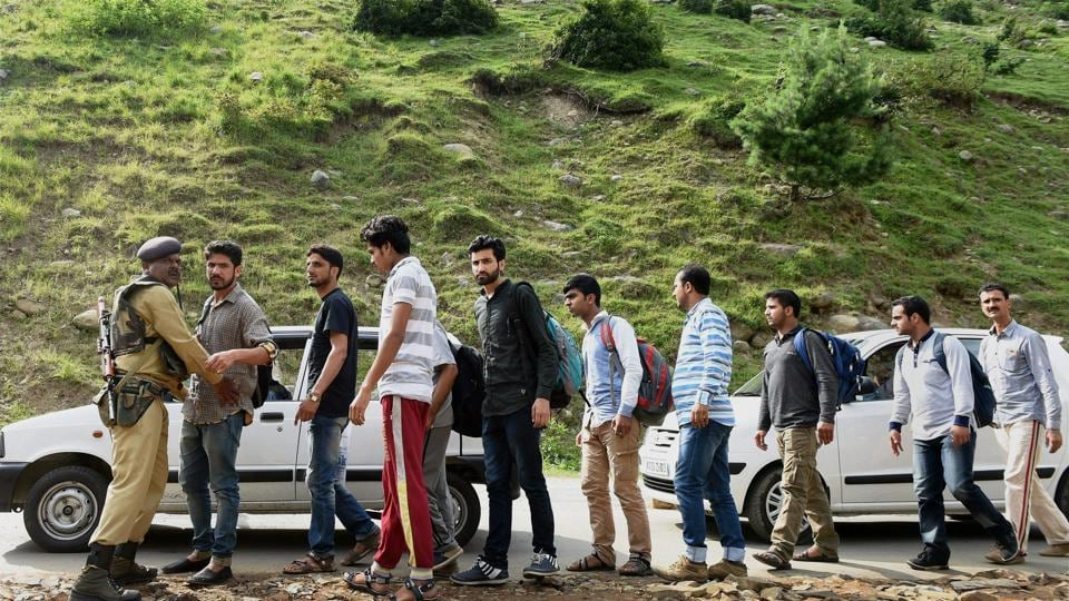 Security personnel check pilgrims and locals at Langalbal Pahalgam base camp following a high alert in Pahalgam, South Kashmir.