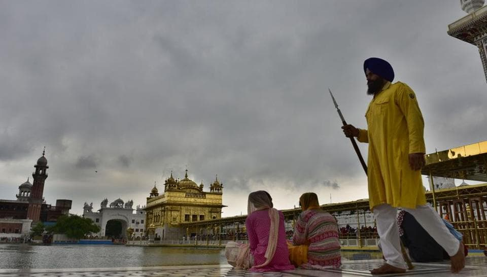 Cloudy weather at the backdrop of Golden Temple in Amritsar on Wednesday. The monsoon season in India lasts from June to September. (Gurpreet Singh/HT Photo)