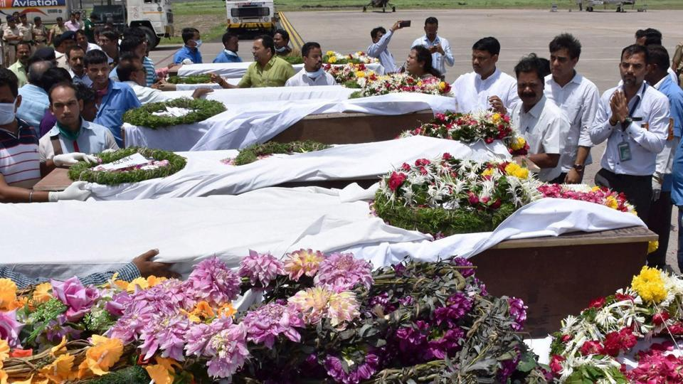People paying tributes to the Amarnath pilgrims who were killed Monday's militant attack at Anantnag in Jammu and Kashmir, after their bodies were brought in an IAF plane at the airport in Surat on Tuesday.