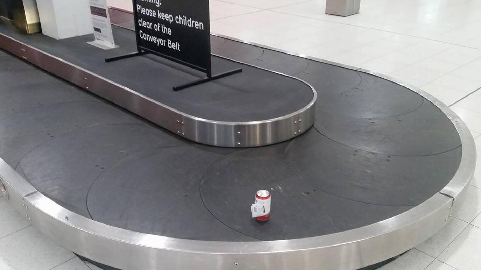This handout photograph taken on July 8 shows a can of beer on a baggage conveyor belt at the Perth Airport.