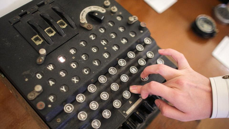 An employee of an auction house presses a key of a working original Enigma cipher machine in Bucharest, Romania.