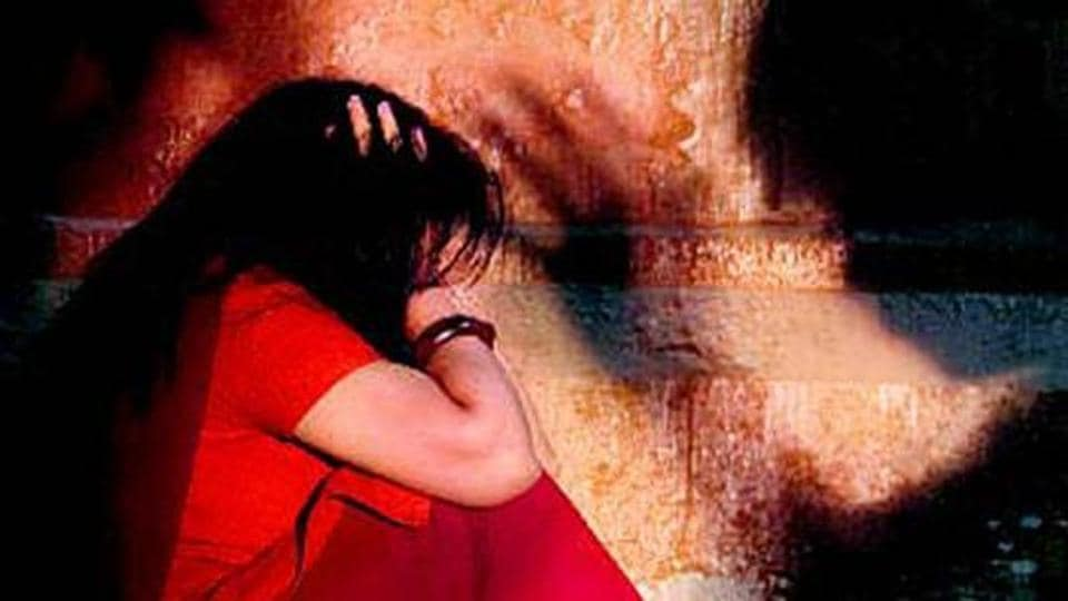 A woman was allegedly raped by two men after her husband bet her while gambling.