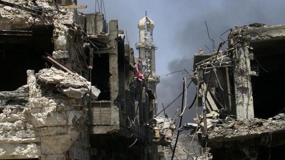 Destroyed buildings from clashes are seen in the Old City of Mosul, Iraq on July 10.