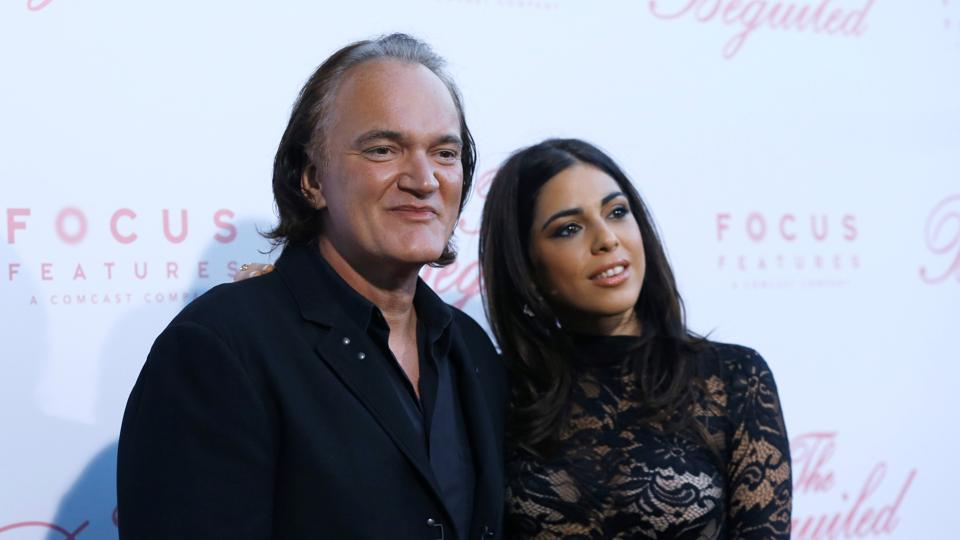 Director Quentin Tarantino and Daniela Pick pose at a premiere for The Beguiled in Los Angeles.