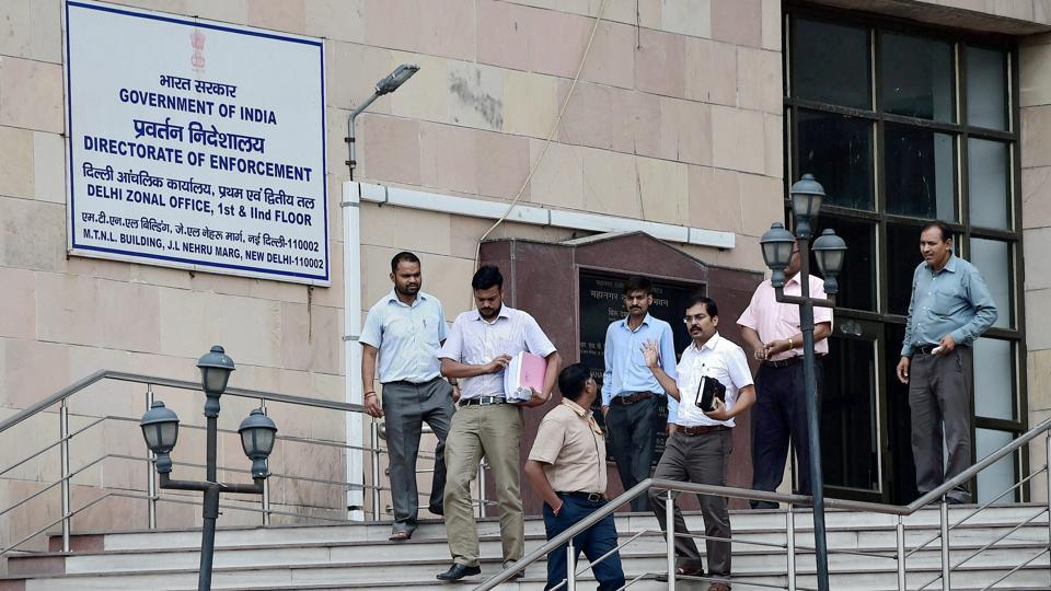 Officials at the Directorate of Enforcement office where RJD leader Misa Bharti appeared, in New Delhi on July 11.