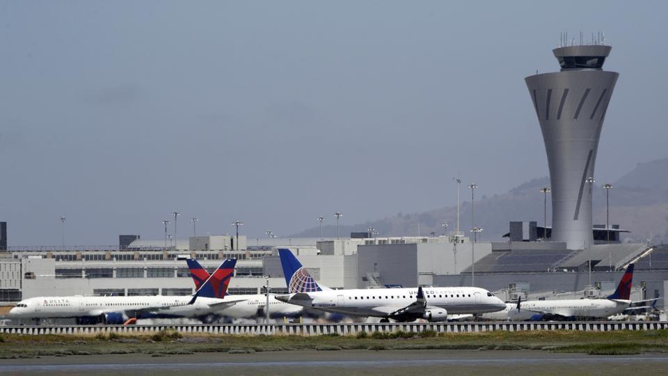 Departing and parked aircraft intersect at San Francisco International Airport.