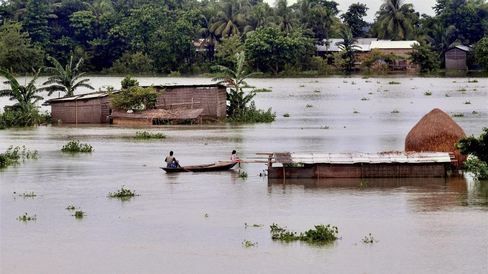 Villagers row a boat to reach to a safer place as incessant rains created a flood-like situation at Kureni Bori in Morigaon district of Assam.