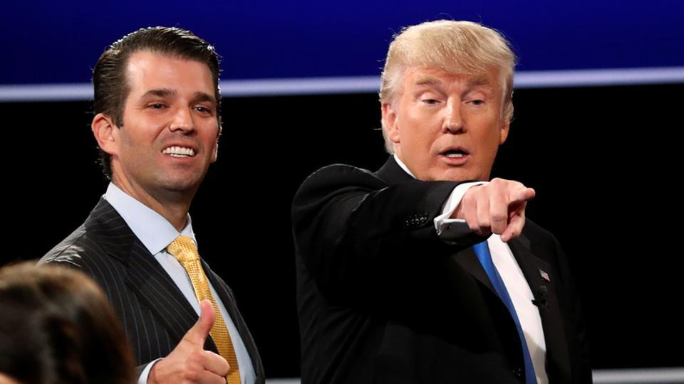 Donald Trump Jr gives a thumbs up beside his father Donald Trump during the US presidential debate in Hempstead, New York, on September 26.