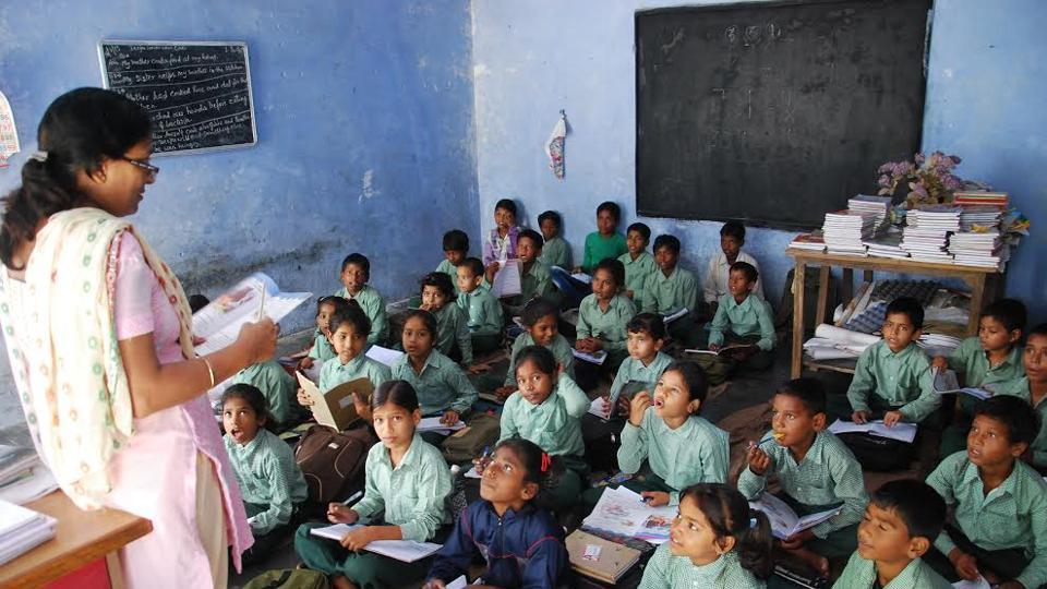 A teacher teaching students in a government primary school.