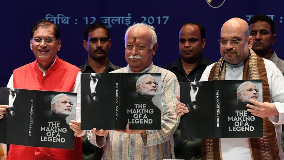 BJP president Amit Shah (R) and RSSpresident Mohan Bhagwat pose during a ceremony for the release of a reverential book on Prime Minister Narendra Modi on July 12.