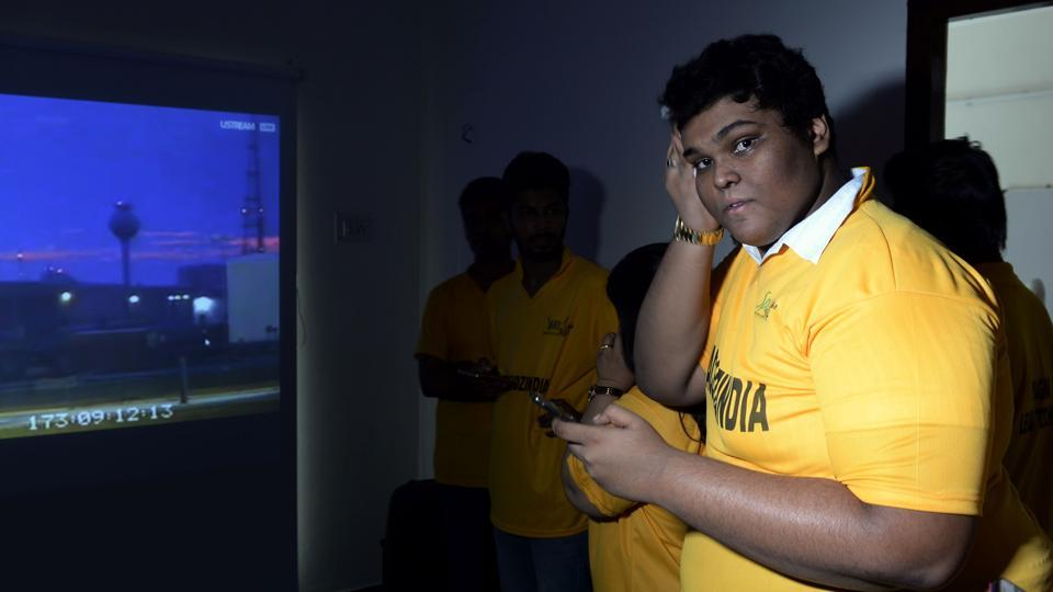 Teenager Rifath Shaarook gestures as he witnesses the launch of his satellite from Nasa's Wallops Island facility live on a screen, in Chennai on June 22.
