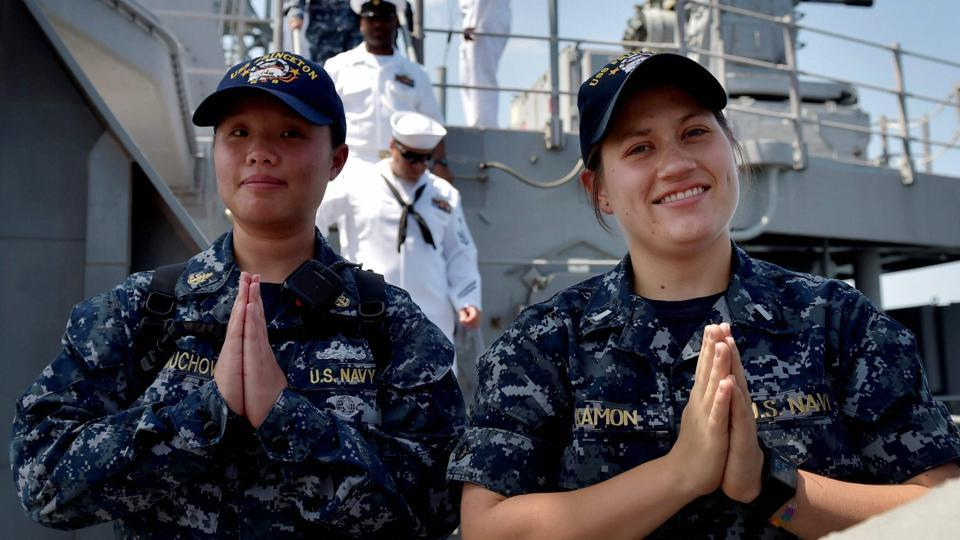US sailors gesture 'Namaste' aboard USS Princeton which arrived at Port Trust in Chennai to take part in 'Malabar Naval Exercise-2017'. The USS Nimitz, the world's largest aircraft carrier, Indian Navy's INS Vikramaditya, and Japan's Izumo helicopter carrier will be among the warships taking part in the exercise. (R Senthil Kumar / PTI)