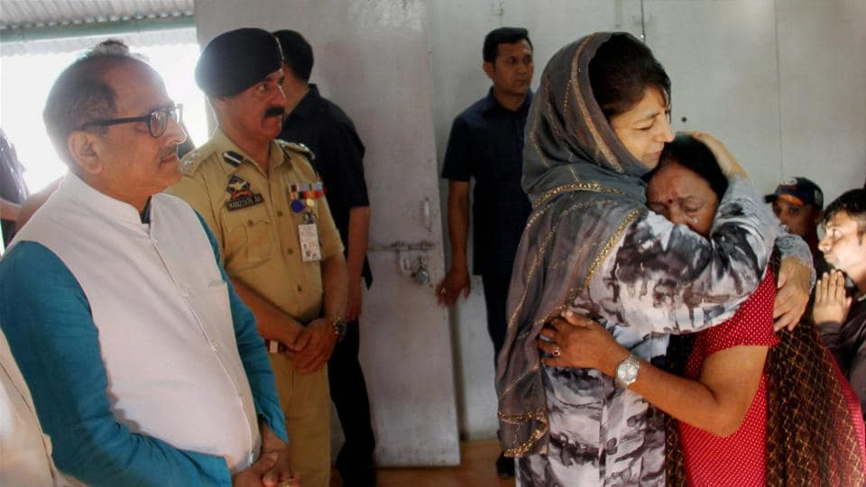 Jammu and Kashmir chief minister Mehbooba Mufti consoles an Amarnath pilgrim who survived the Anantnag terror attack at the airport in Srinagar on Tuesday.