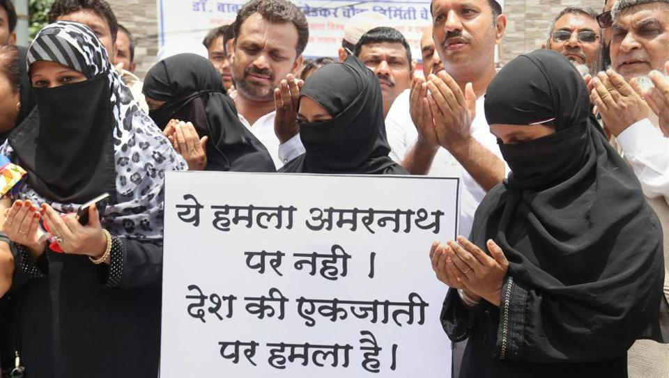 People in Mumbai protest against the Amarnath Yatra attack.